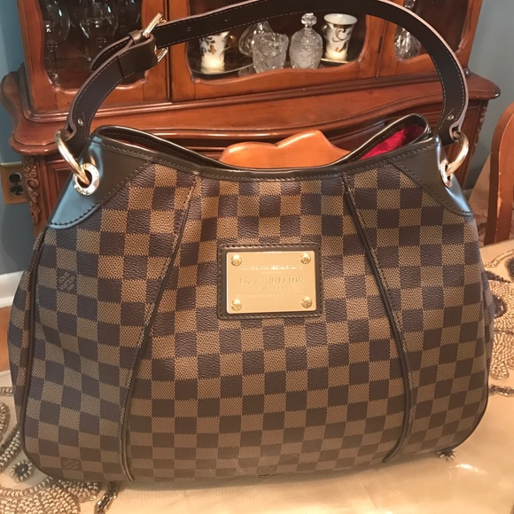 Handbags - Lv damier ebene never used