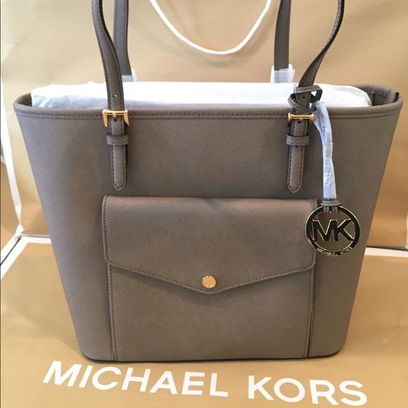 200c42074ba937 Michael Kors Bags | Jet Set Dk Dune Lg Pocket | Poshmark