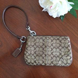 Coach Handbags - Coach Signature brown wristlet w/ leather accents