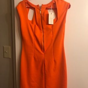 Dresses & Skirts - Very cute orange Stretchy material. Brand new