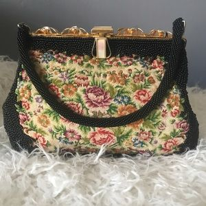 Vintage beaded clutch bag with tapestry front.