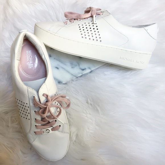 d5546bda30828 Michael Kors Poppy Lace-Up White Sneakers. M 5933616a7f0a058aa1022591