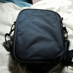 c8243db76b Tumi Bags - Tumi unisex deep blue small crossbody bag