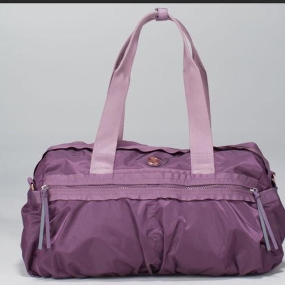 0a17c92bb42 lululemon athletica Handbags - Lululemon gym to win duffle bag purple