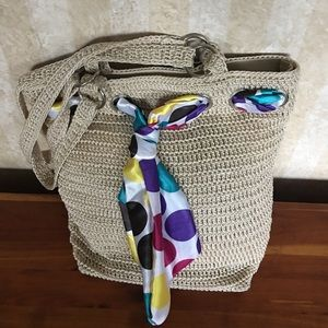 Purse with colorful scarf accent.