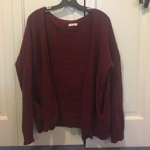This is a maroon cardigan from Urban Outfitters.
