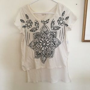 white top black floral painting [ Title Unknown ]