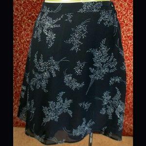 no brand  Dresses & Skirts - Black w/gray floral A-line skirt 8P