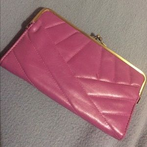 Magenta clutch with gold detailing