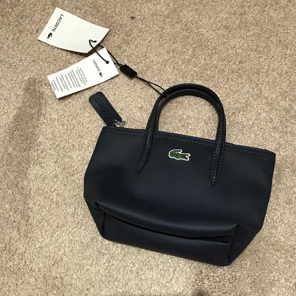 7027bd8a94 Lacoste Bags | Navy Mini Pouch | Poshmark