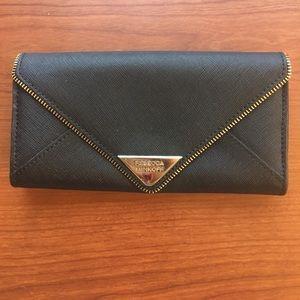 c38d6ea442e9 Rebecca Minkoff large exposed zipper wallet