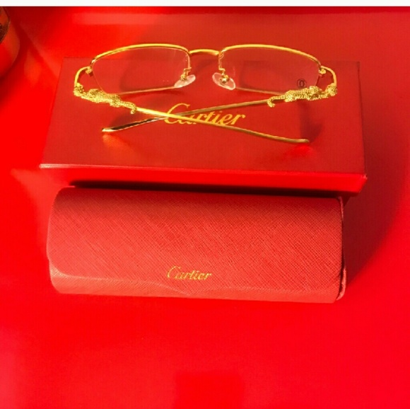 c93d9ae9841 Cartier Other - Cartier gold panther clear frames