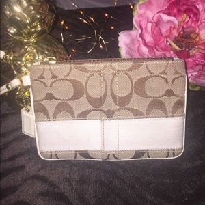 Coach Handbags - Tan & White Coach Wristlet 👜
