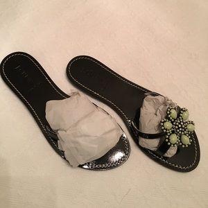 Black patent jeweled slip-on sandal.