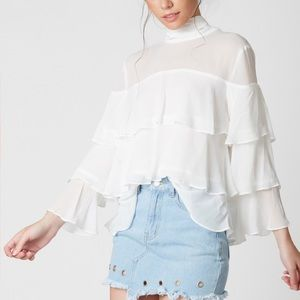 RUFFLE DARE MOCK NECK TOP in Ivory
