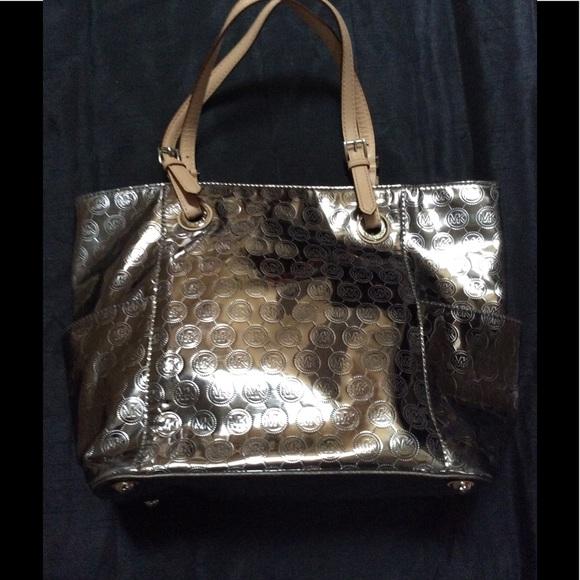 8a5362cd3255 Michael Kors Jet Set Mirror Metallic Tote Bag. M_593936655a49d01cbc02b152