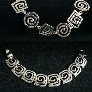 Silver geometrical necklace set