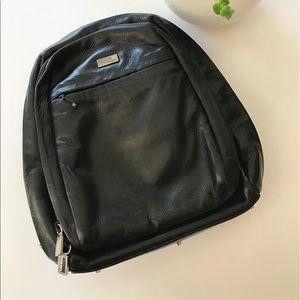 Perlina Handbags - Perlina small black leather backpack