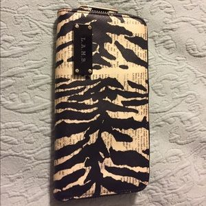 Lamb Handbags - L.A.M.B. Wallet zebra on newspaper print rare find