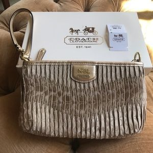 Coach Handbags - NWT Coach gold metallic clutch/wristlet