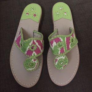 Jack Rogers pink and green flip flops.