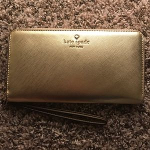 kate spade Handbags - NWT Kate Spade Gold Leather Wristlet