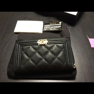 CHANEL Handbags - Chanel small zip wallet veau black used 2x,