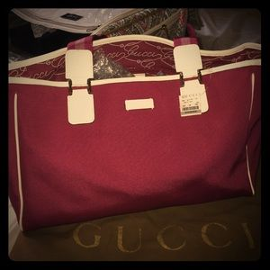 Gucci tote burgundy tags attached with cream leath