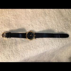 Gucci Accessories - Gucci Gold & Black leather watch