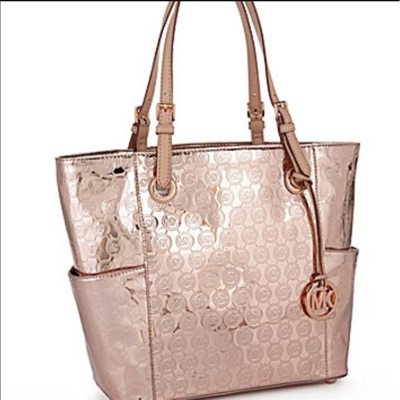 cbca59243 Michael Kors rose gold purse. Opened to offers ! M_593f34f07f0a05fd0a015006