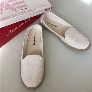 White lace fabric flats with eyelets and rope