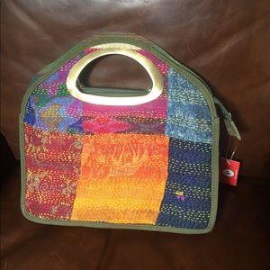Awesome fun golden handled vibrant tribal handbag