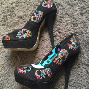 Iron fist rainbow skull heels