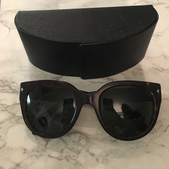 bec5602a57ed 57% off Prada Accessories - Prada Cat Eye Sunglasses with case from  Lauren  39