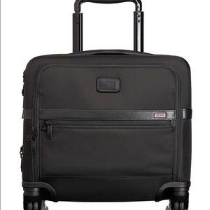 Tumi Handbags - EUC Tumi 4-wheel Compact Brief