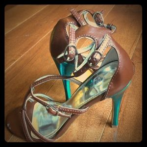 Brown strappy sandals with bright blue heels