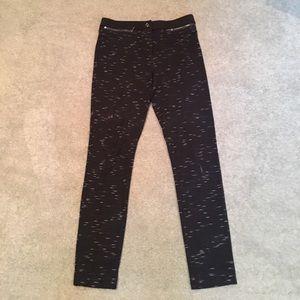 Black leggings with white stripes.