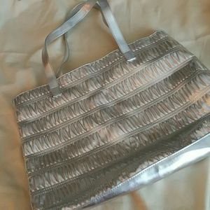Clinique Handbags - Clinque Silver Tote Bag