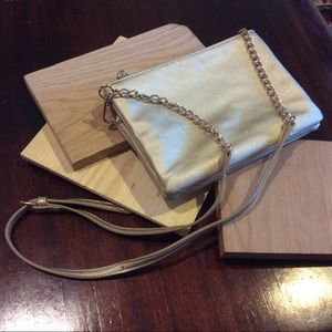 Gold crossbody bag with double zipper closure