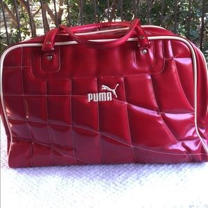 Other - Puma duffel bag in deep red with cream welt accent