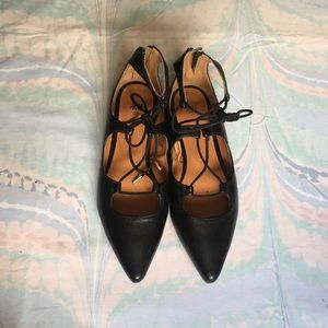 Chic black faux leather laced flats from H&M