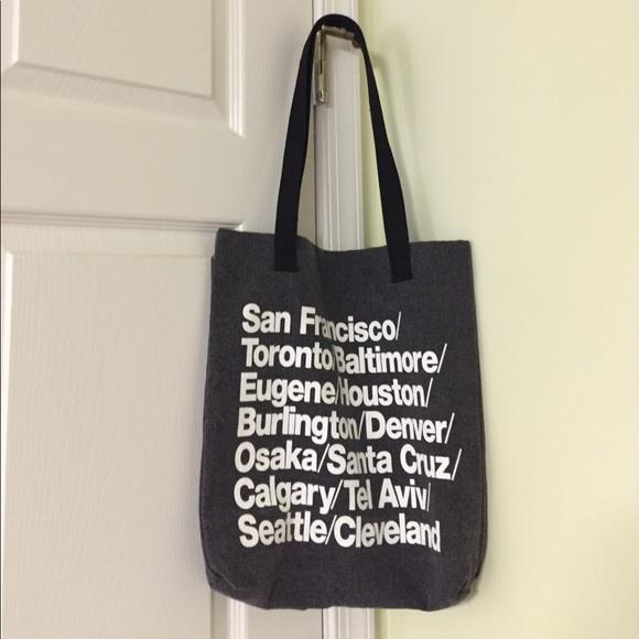 850fe609fa7 American Apparel Handbags - American Apparel tote bag with city names on it