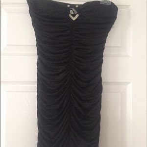Strapless small gathered form fitting black dress