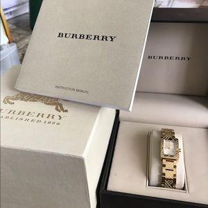Burberry women's gold watch