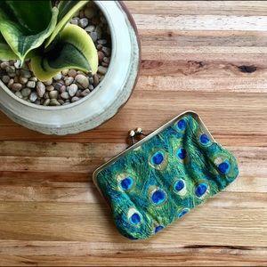 Handmade peacock feather print clutch