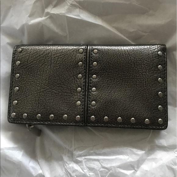 cc5141fffe91 Michael Kors Silver Studded Leather Wallet. M 5949de0abf6df5ce9c02cf8a