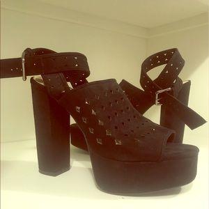 Black cut-out heels.