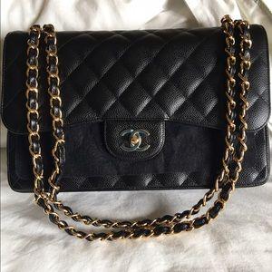 CHANEL Handbags - CHANEL Jumbo Iconic Caviar Handbag in Black & Gold
