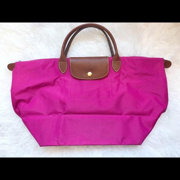 9407c43e7fbf Longchamp Handbags - Fuchsia Longchamp Le Pliage Medium Tote