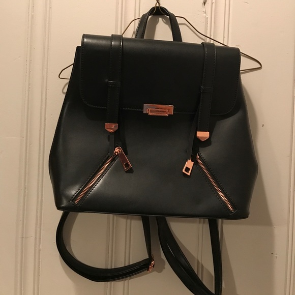 81896a885 Lionel Bags | Black And Rose Gold Backpack | Poshmark